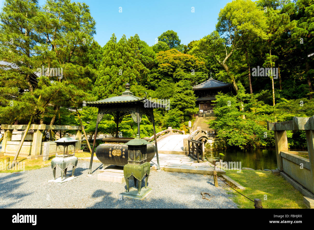 Japanese Garden Stone Bridge part of japanese garden, a gravel path and stone bridge over a