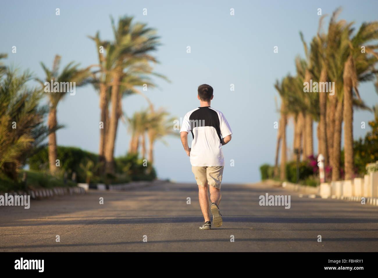 Man Running Away From Camera