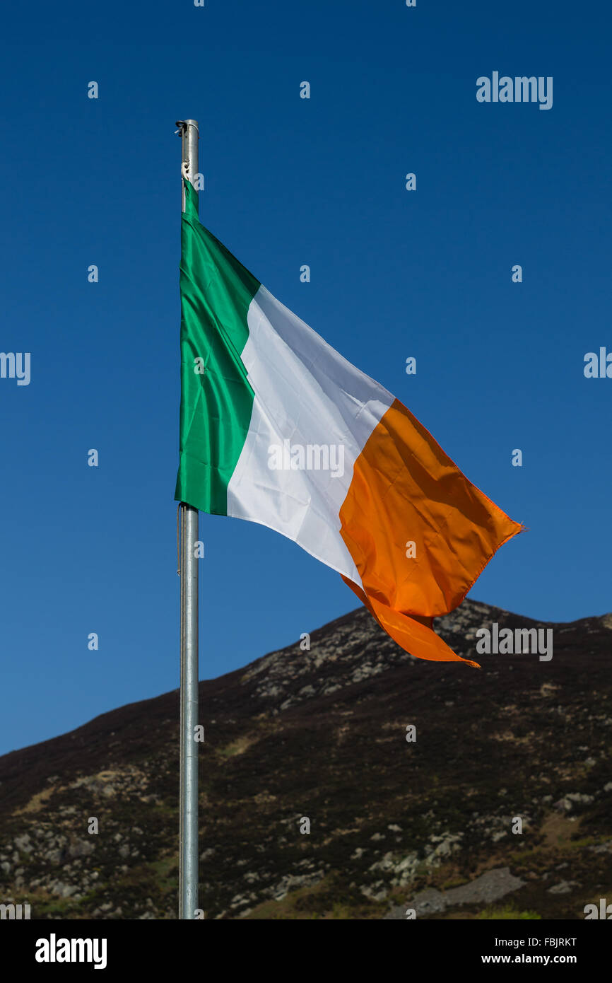 the irish tricolour flag flies on white pole in county armagh