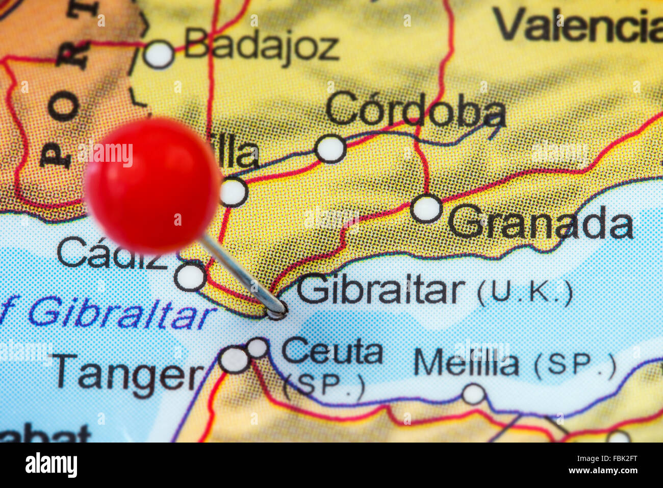 Closeup of a red pushpin in a map of Gibraltar Stock Photo