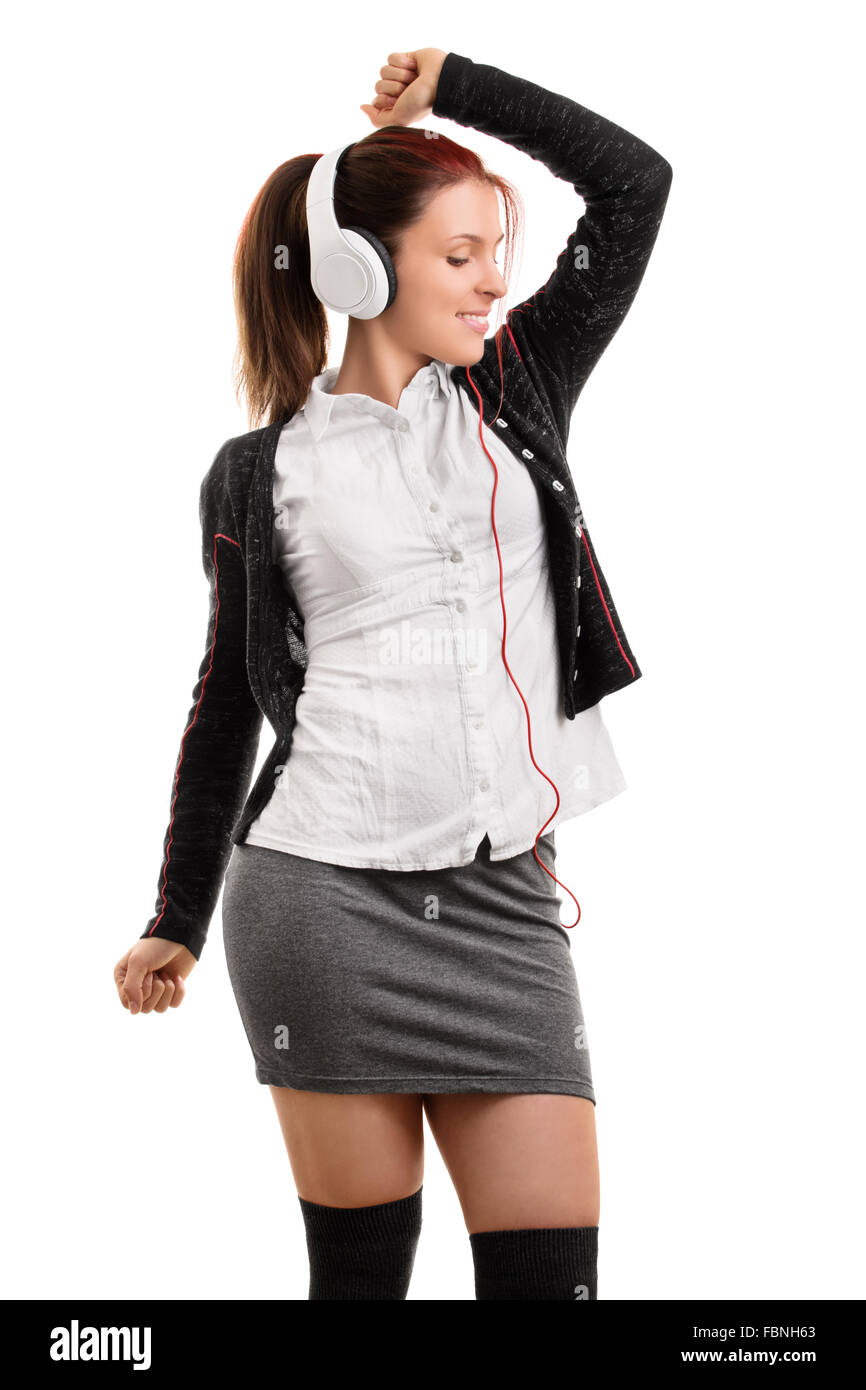 school girl in uniform listening music and dancing