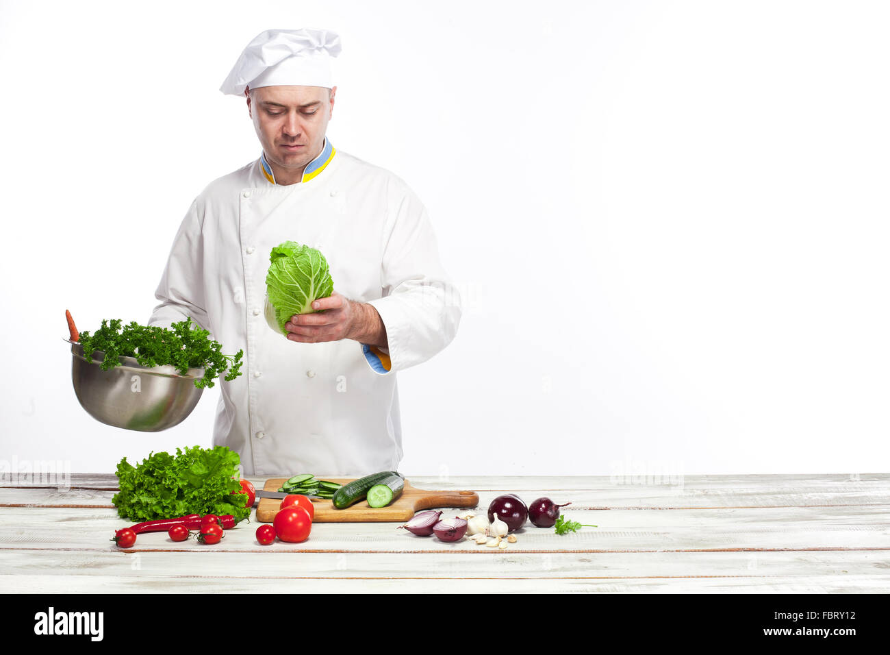 Chef cooking fresh vegetable salad in his kitchen stock for Fresh chef kitchen