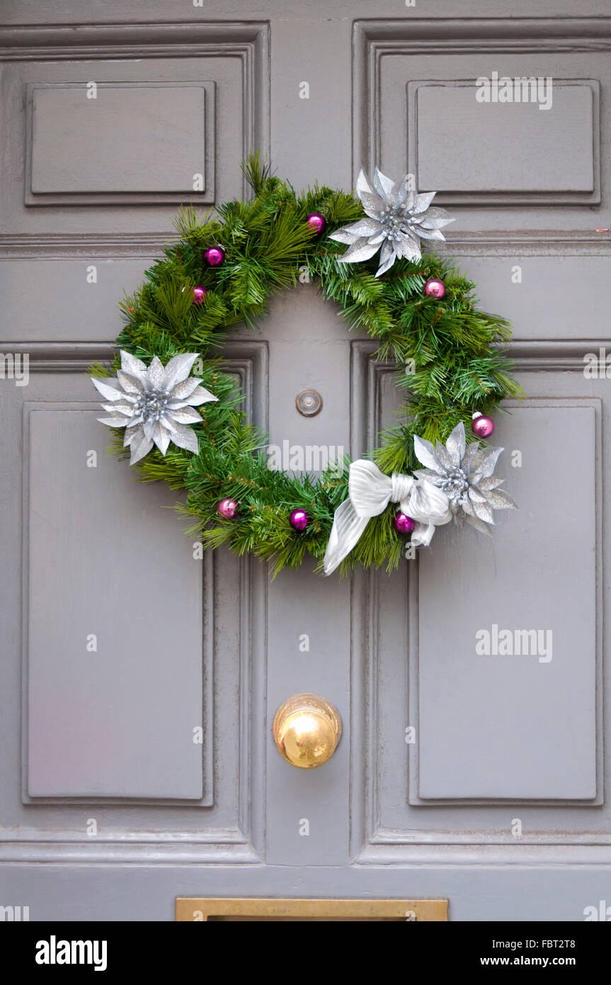 Christmas Wreath On Grey Front Door Hanging