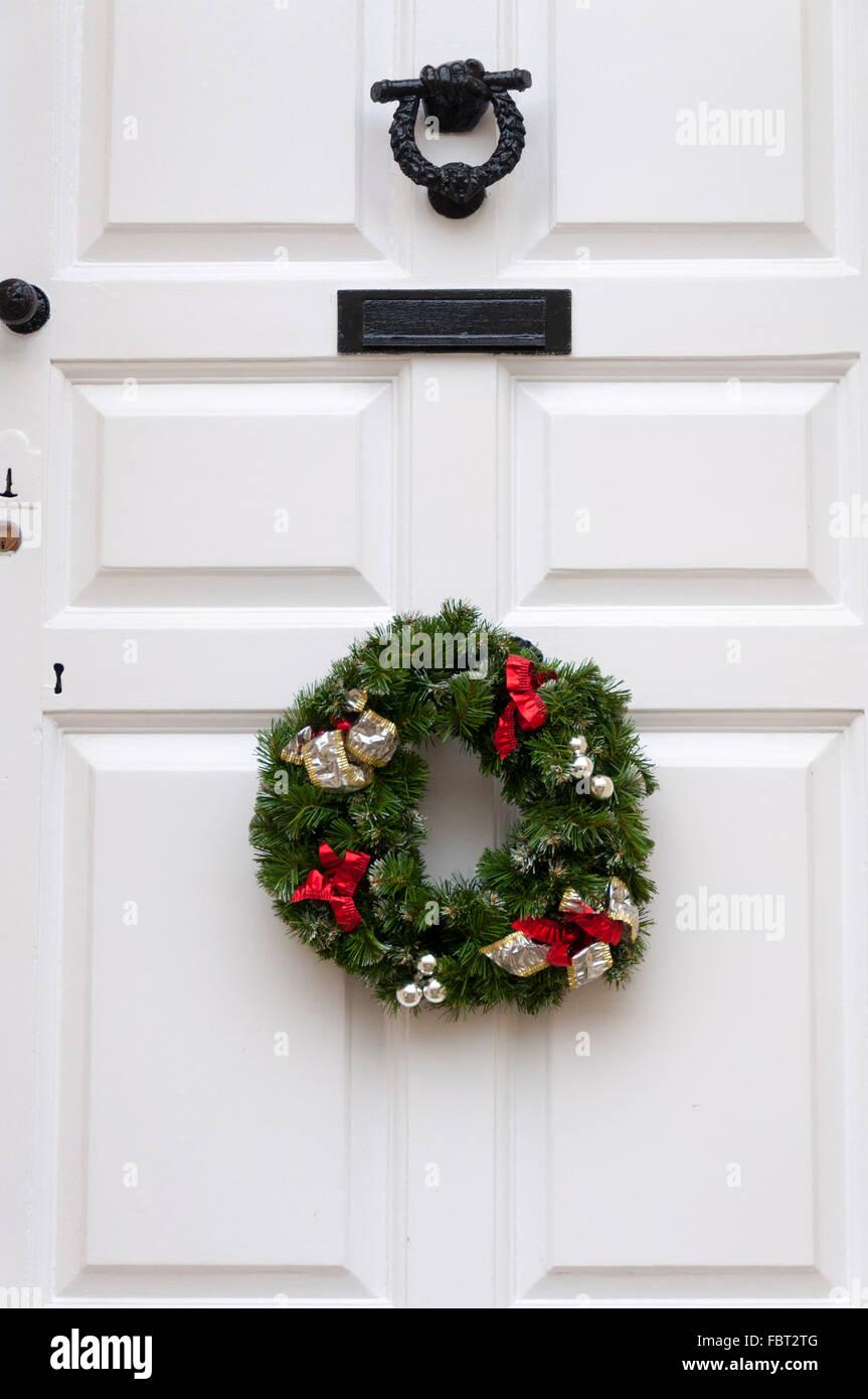 Christmas Wreath On White Front Door Hanging