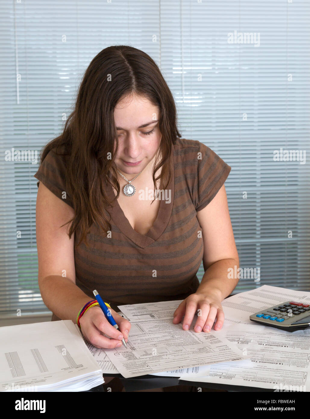 Young lady preparing usa tax form 1040 for 2012 stock photo royalty young lady preparing usa tax form 1040 for 2012 falaconquin
