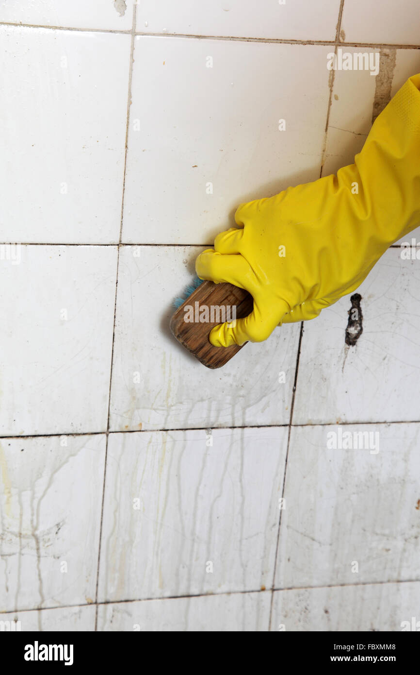 Cleaning of dirty old tiles in a bathroom Stock Photo: 93400056 - Alamy