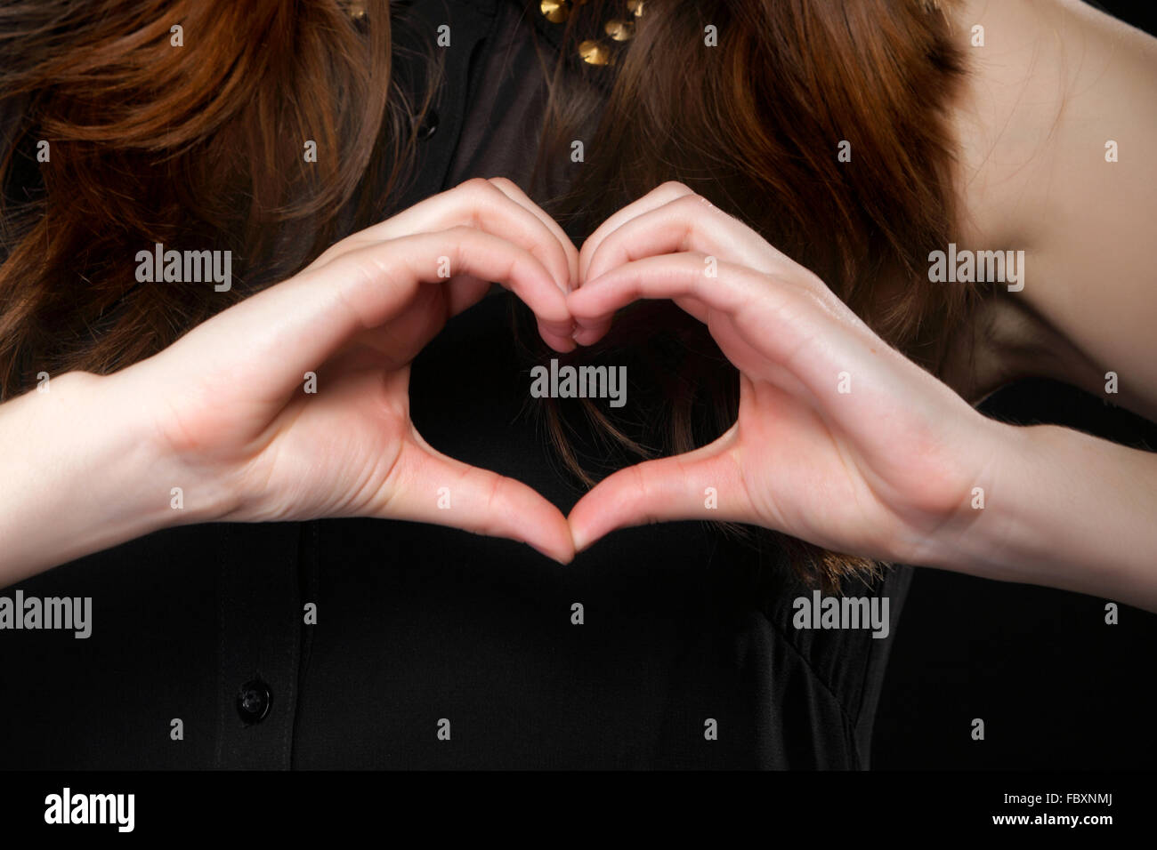 Girl doing heart shape love symbol with her hands Stock Photo ...