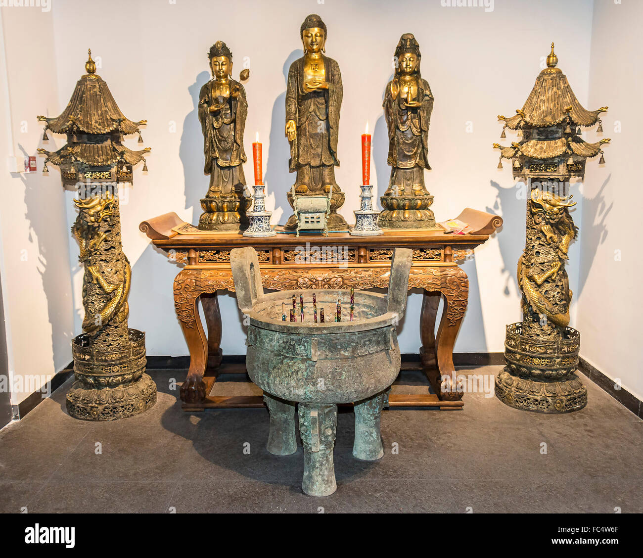 Buddhist Shrine With Rosewood Table, Statues And Incense Bowl. On Disiplay  At Zhen Qi Hui Art Center In Hangzhou, China,