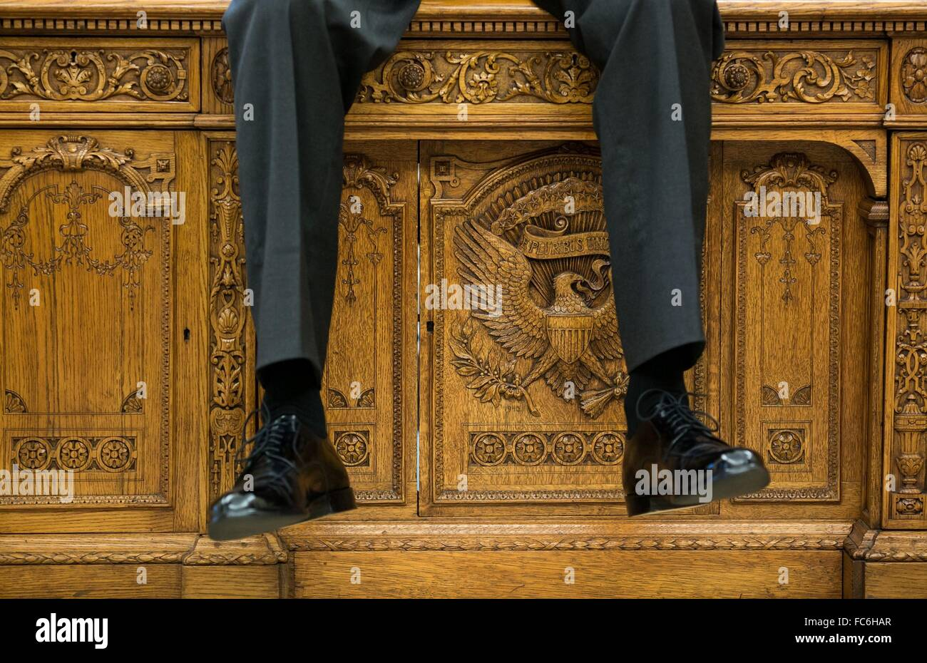 oval office resolute desk. U.S President Barack Obama Hands His Legs Over The Resolute Desk During A Meeting With Aides In Oval Office Of White House October 1, T