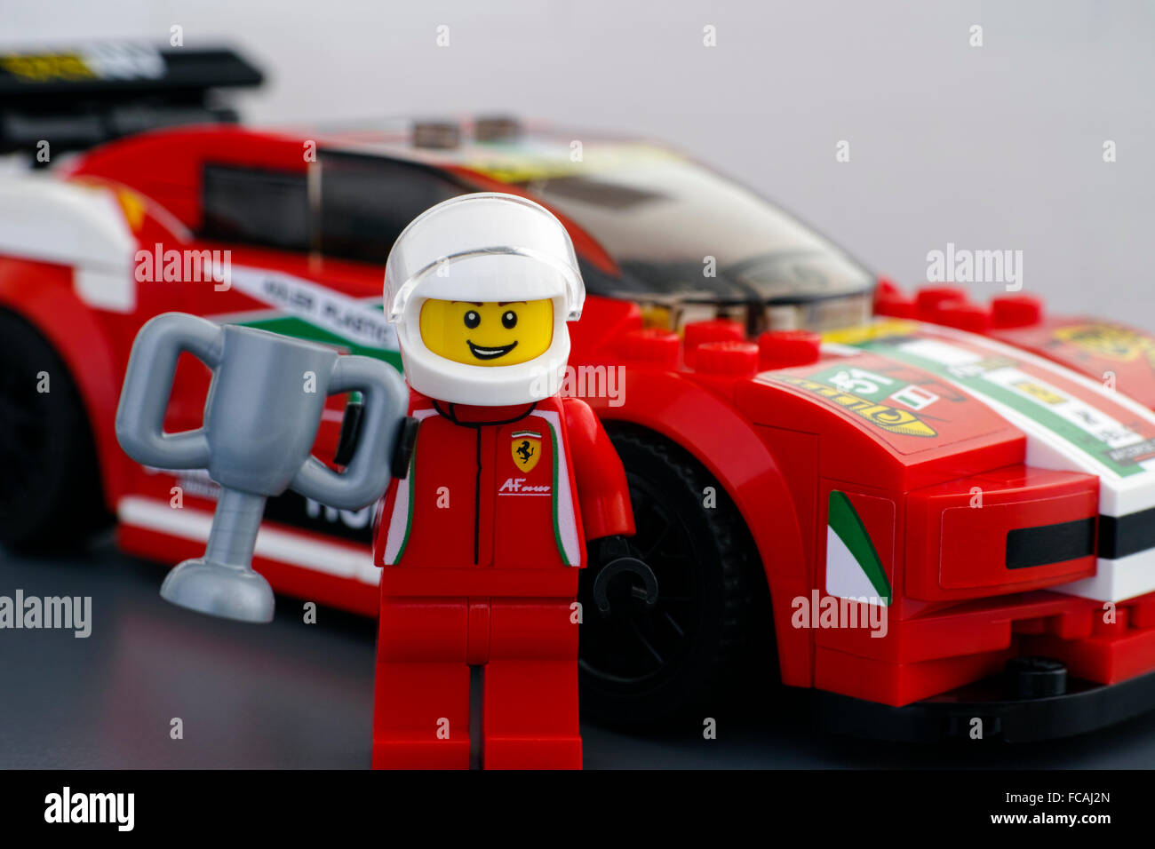 lego ferrari driver minifigure with cup by lego speed champions and stock photo royalty free. Black Bedroom Furniture Sets. Home Design Ideas