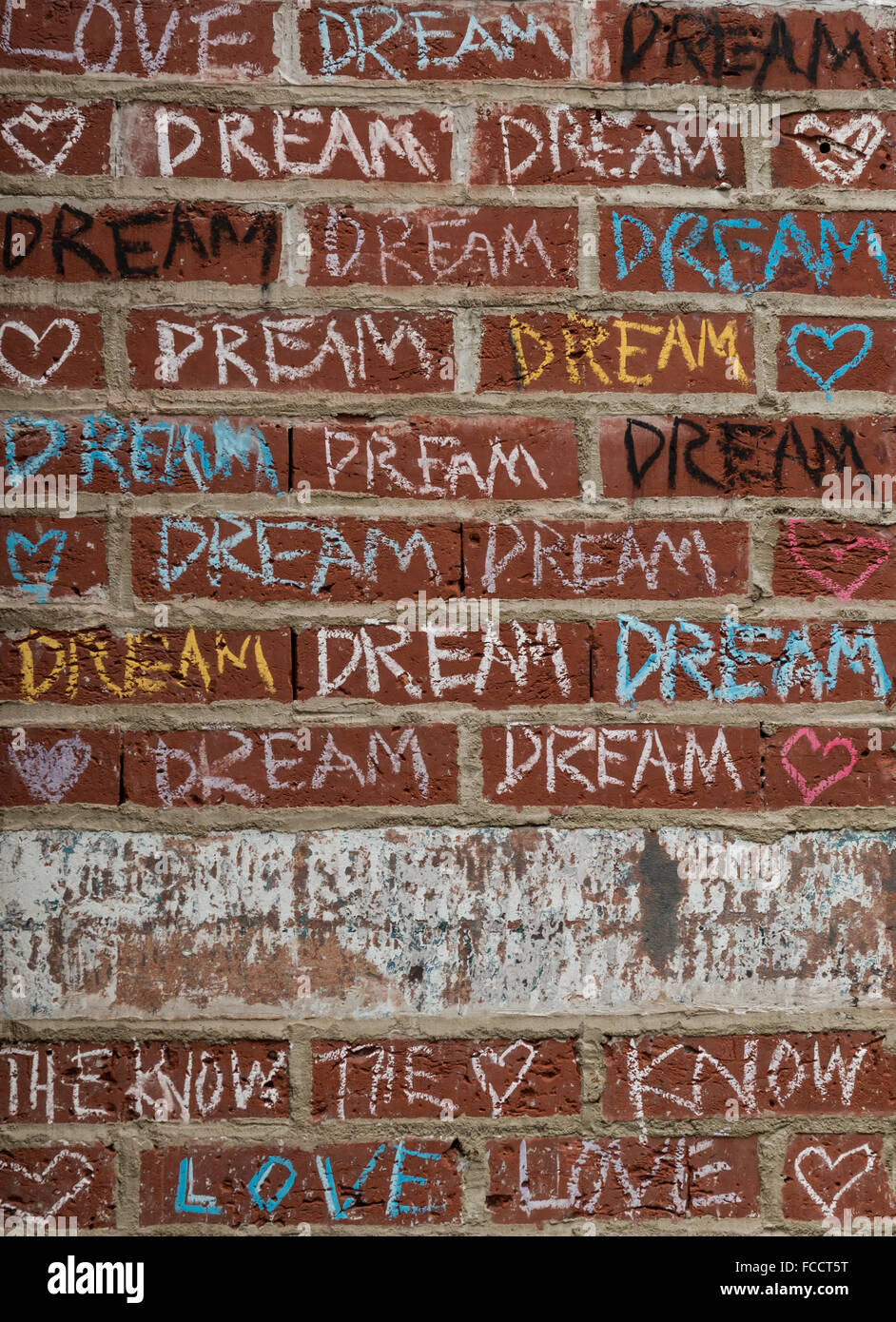 Grafiti wall red - Coloured Chalk Graffiti On A Red Brick Wall With The Words Love Dream And The Know On The Outside Of A Shop