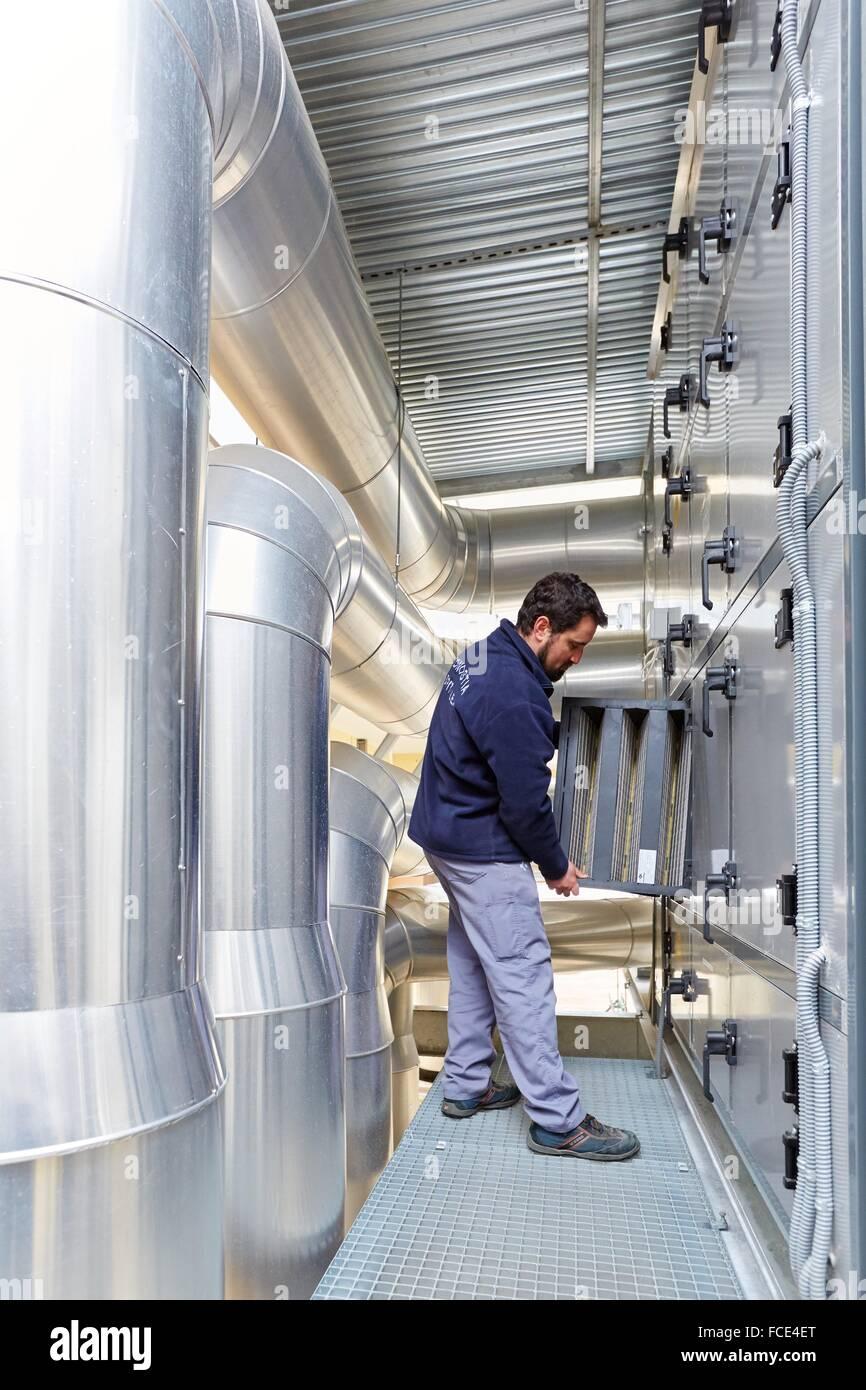 maintenance worker, installation of air conditioning, ventilation