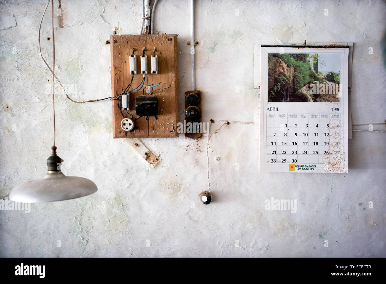 wall of an old workshop an electrical fuse box and plug a stock photo wall of an old workshop an electrical fuse box and plug a calendar from 1986 on the wall and a lamp hanging from