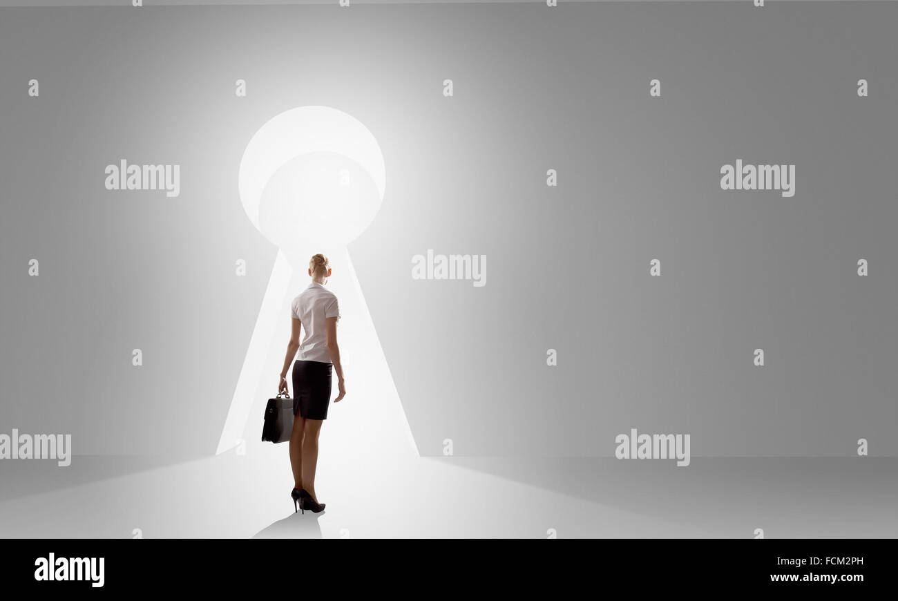 Back view of businesswoman standing in keyhole doorway & Back view of businesswoman standing in keyhole doorway Stock Photo ... pezcame.com
