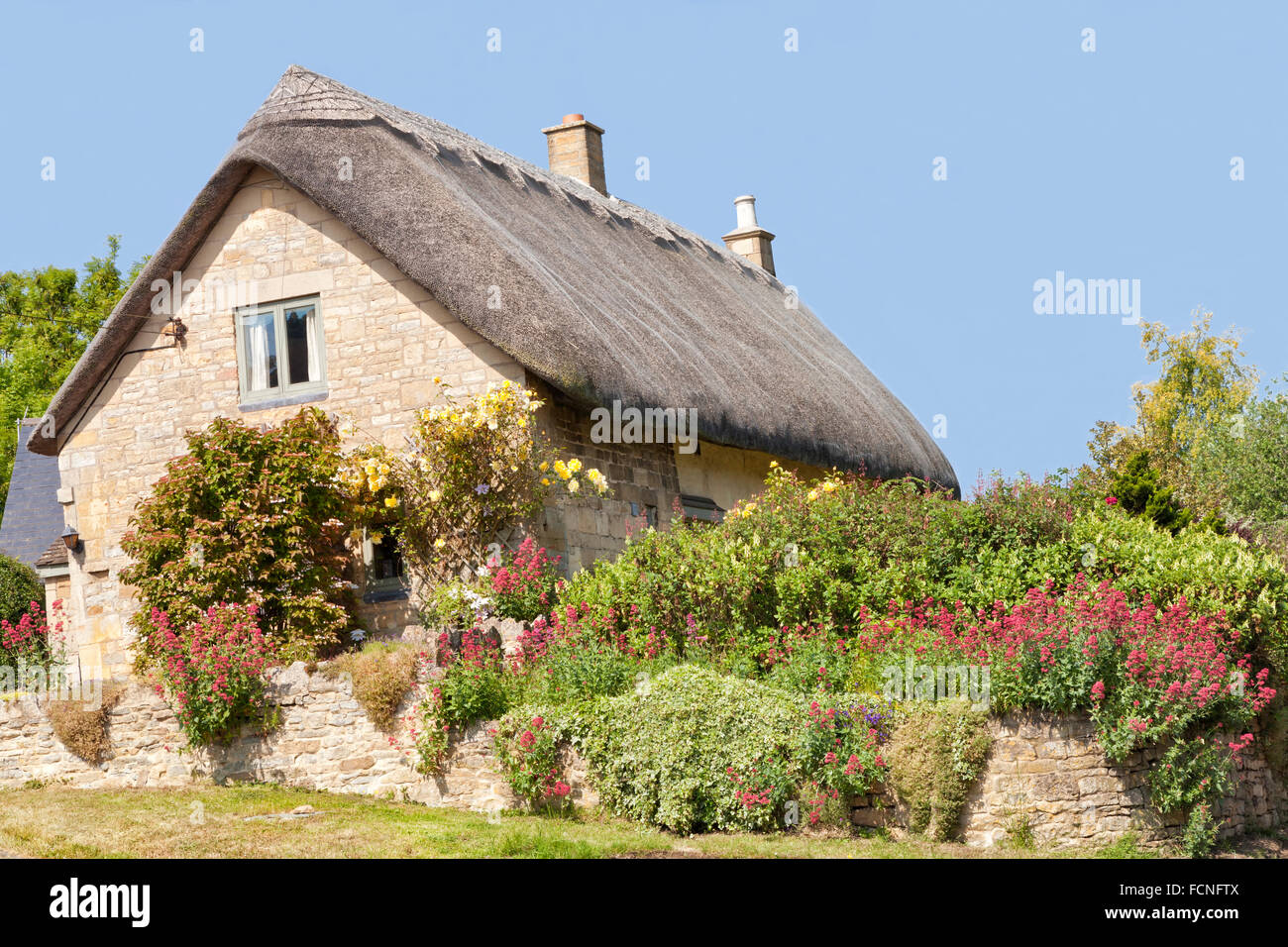 Traditional Old Thatched Roof Stone Cotswold Cottage