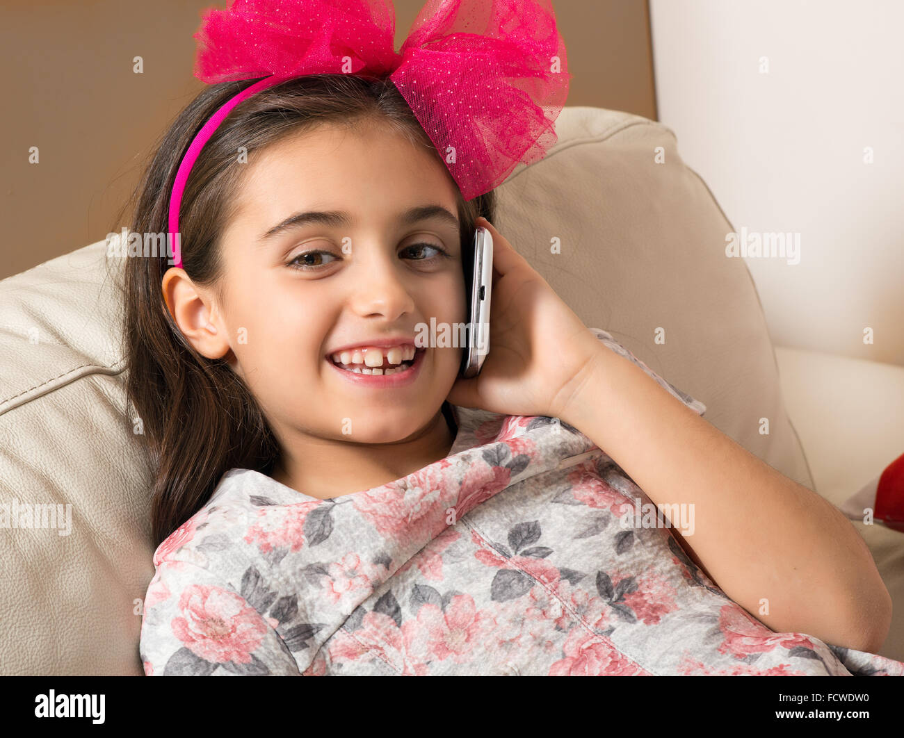 pretty little girl with a lovely happy smile and a bright. Black Bedroom Furniture Sets. Home Design Ideas