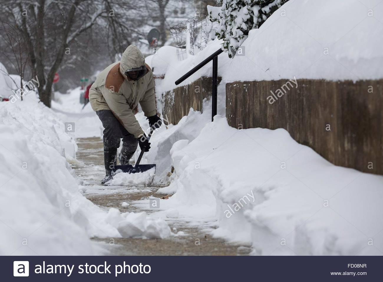 Worksheet 61 Centimeters epa05121222 a man shovels snow from the sidewalk in front of his stock photo home washington dc suburb mount rainier