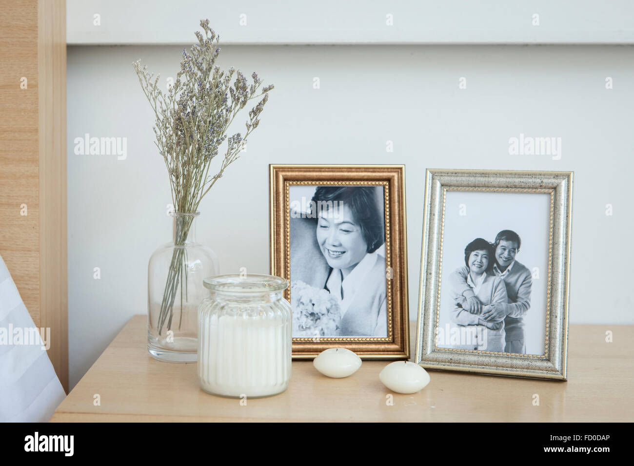 Old photos of senior couple in frames placed with other interior ...