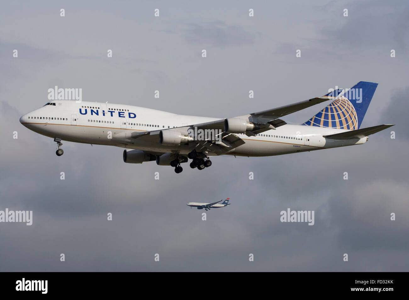 Stock Photo  United Airlines Boeing 747400 Landing In Frankfurt Parallel  To Us Airways A330