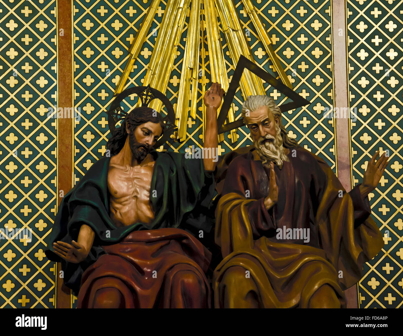 a sculpture of god and jesus in the almudena cathedral of madrid