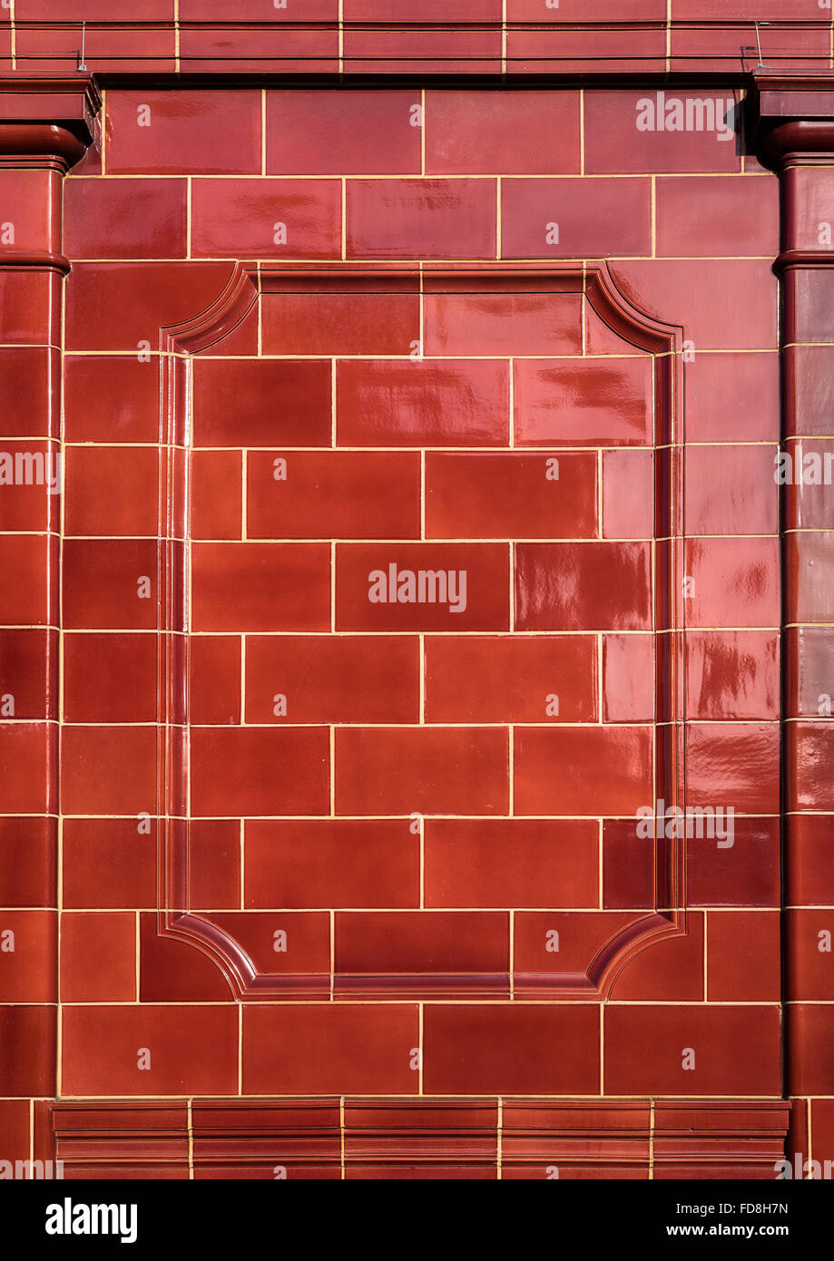Red glazed old victorian ceramic tiles background stock photo victorian red brick tiles on the exterior of an underground station london stock dailygadgetfo Gallery