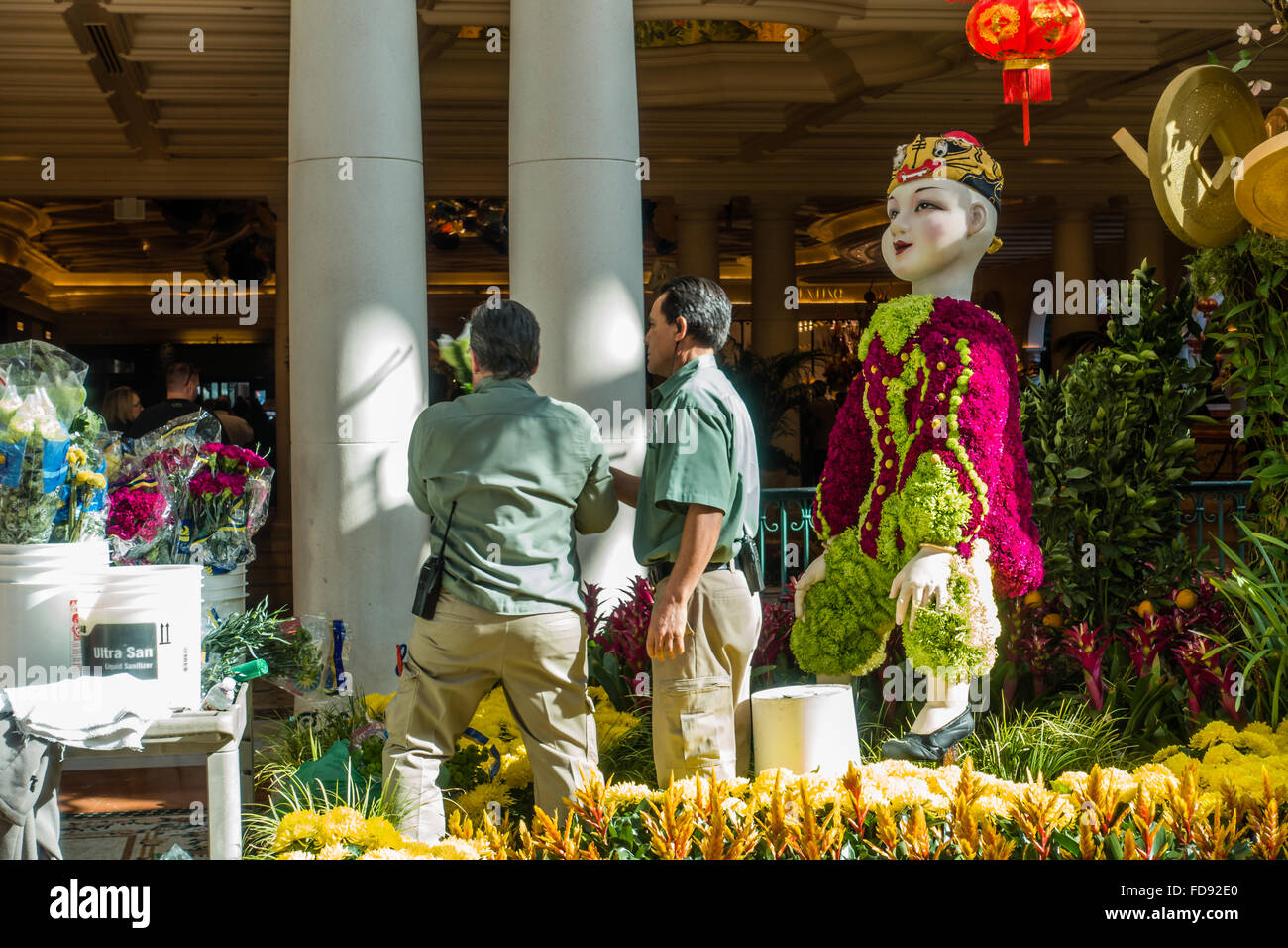 Charming Gardeners Maintaining The Flower Beds At The Gardens In The Bellagio Casino  And Resort In Las Vegas, Nevada, USA