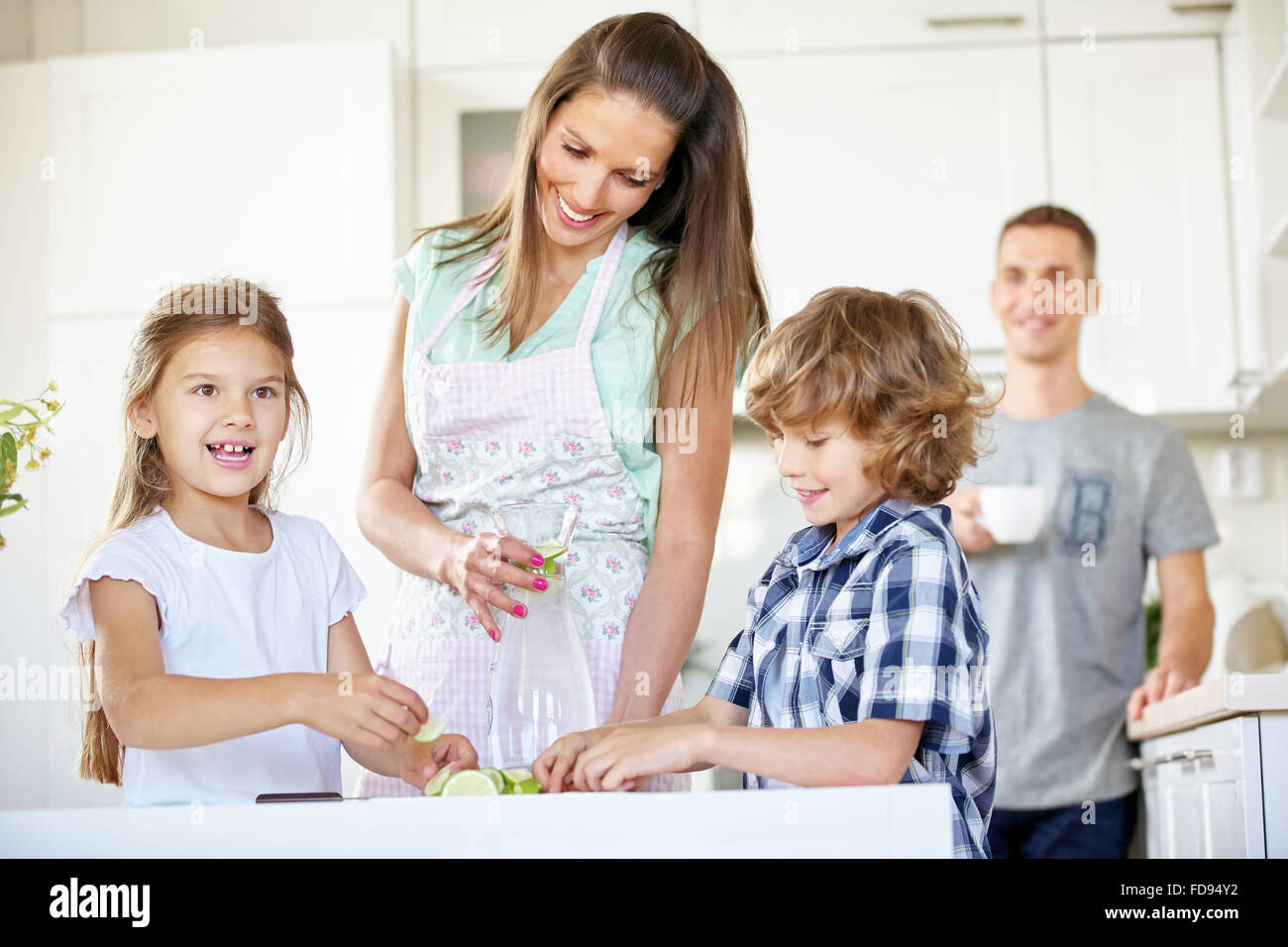 happy family drinking water with fresh lime in the kitchen stock, Kitchen design