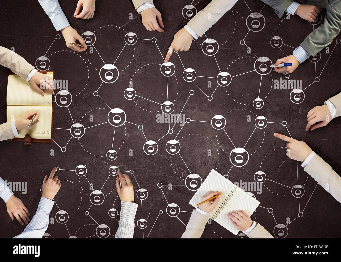 top view of people hands drawing networking strategy stock photo stock photo top view of people hands drawing networking strategy