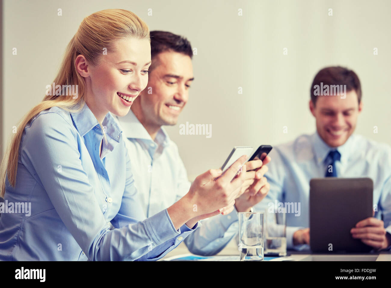 Business People Using Smartphones