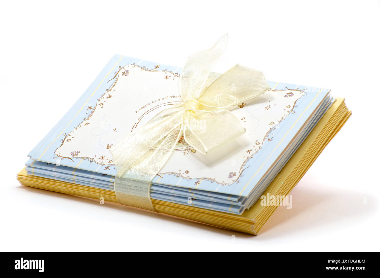 Stack of greeting cards with yellow envelopes over white stock photo stack of greeting cards with yellow envelopes over white kristyandbryce Images