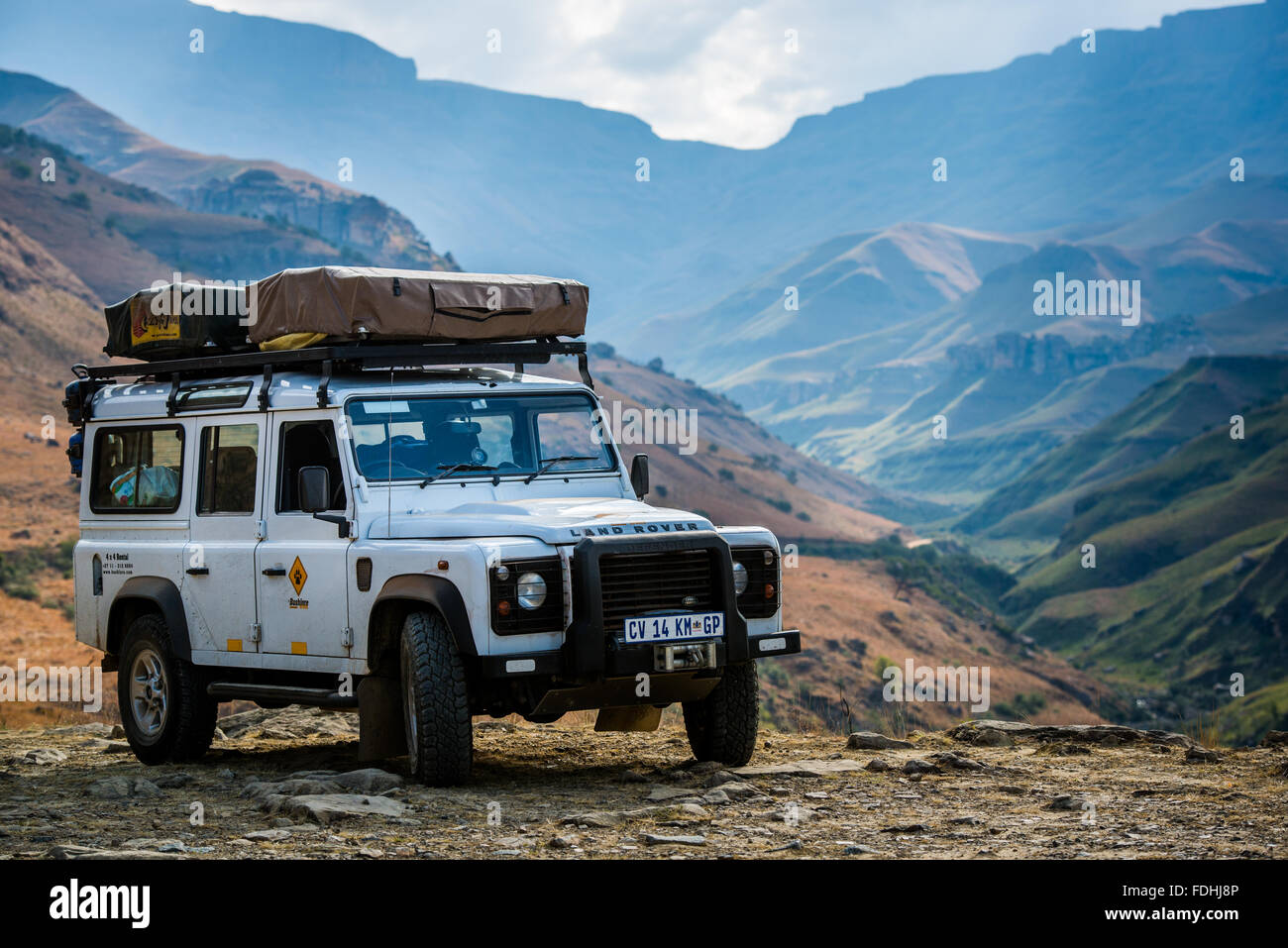 Land Rover Defender Parked With Mountains In The