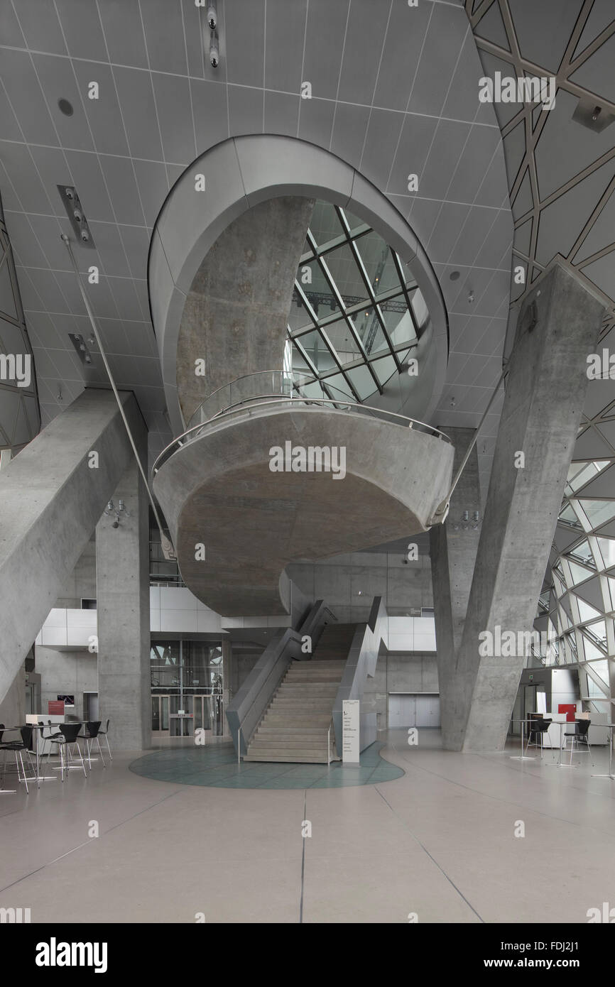 Stock Photo Foyer With Concrete Spiral Staircase And Slanted Columns