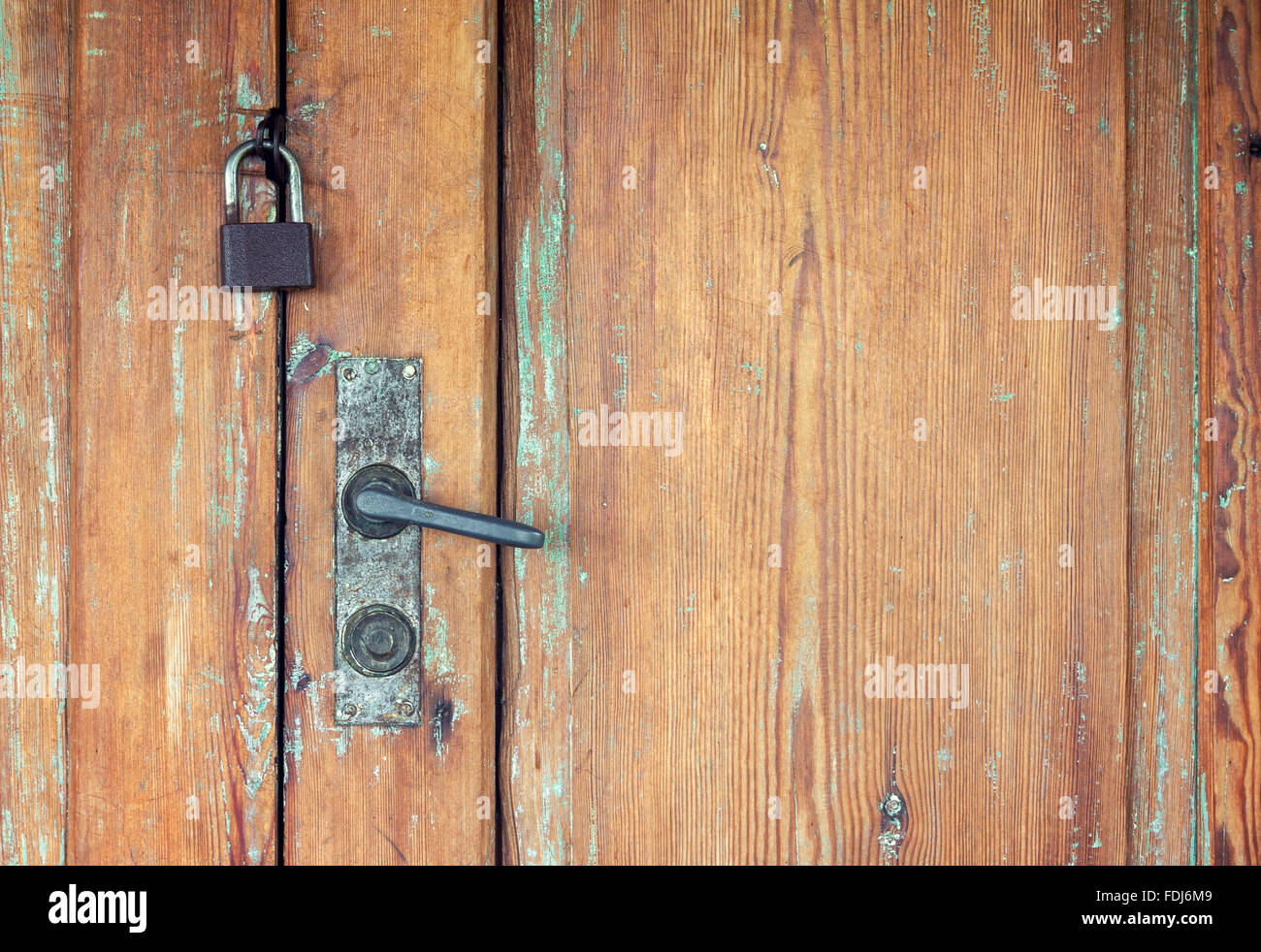 Rusty Door weathered wooden doors with rusty door handle and padlock stock