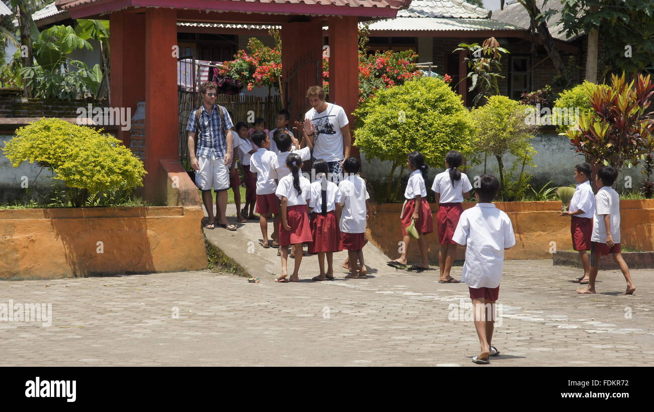 Children greeting tourists in remote indonesian school stock photo children greeting tourists in remote indonesian school m4hsunfo