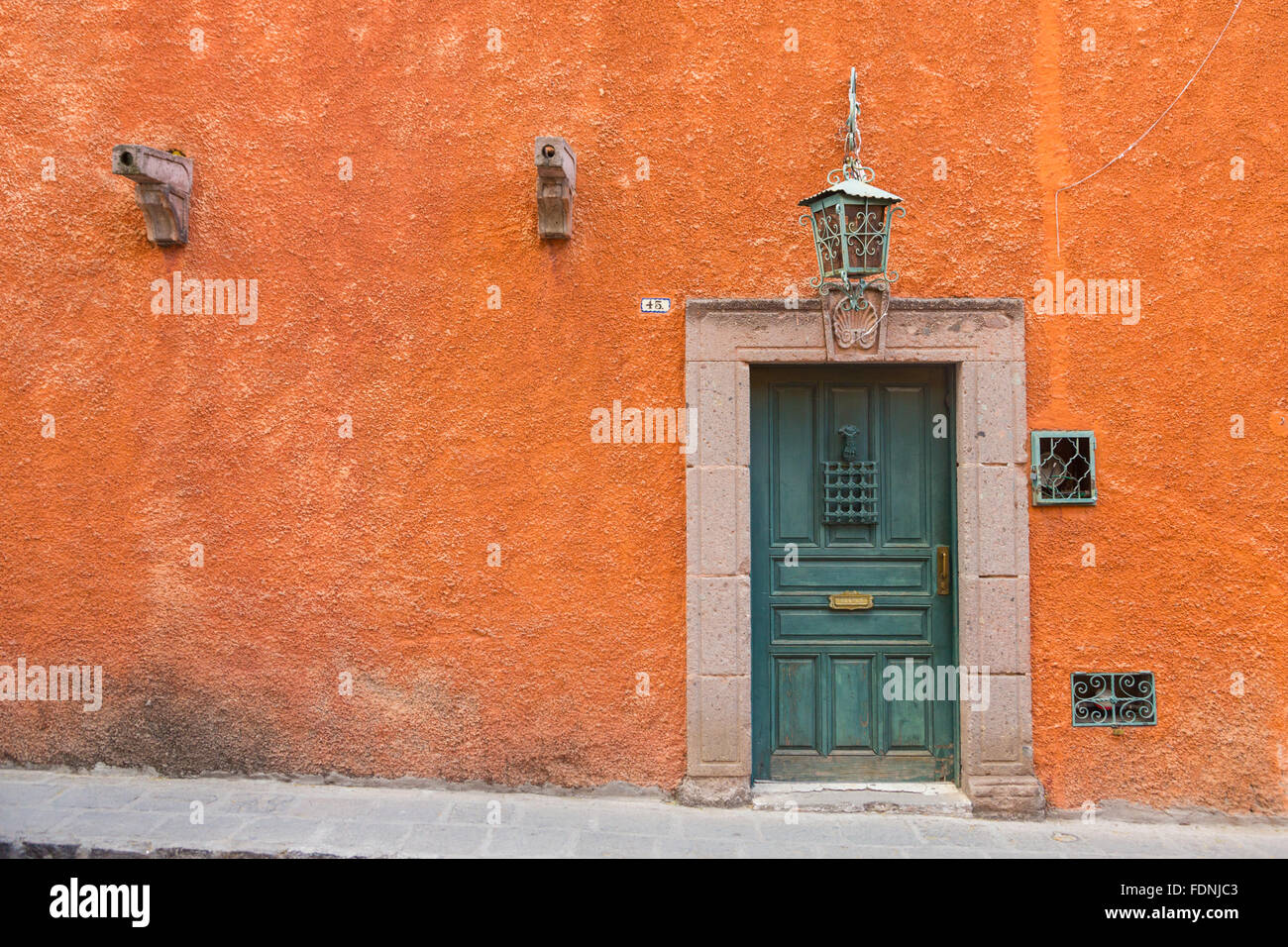 Spanish colonial style homes and old wooden door along for Door in spanish