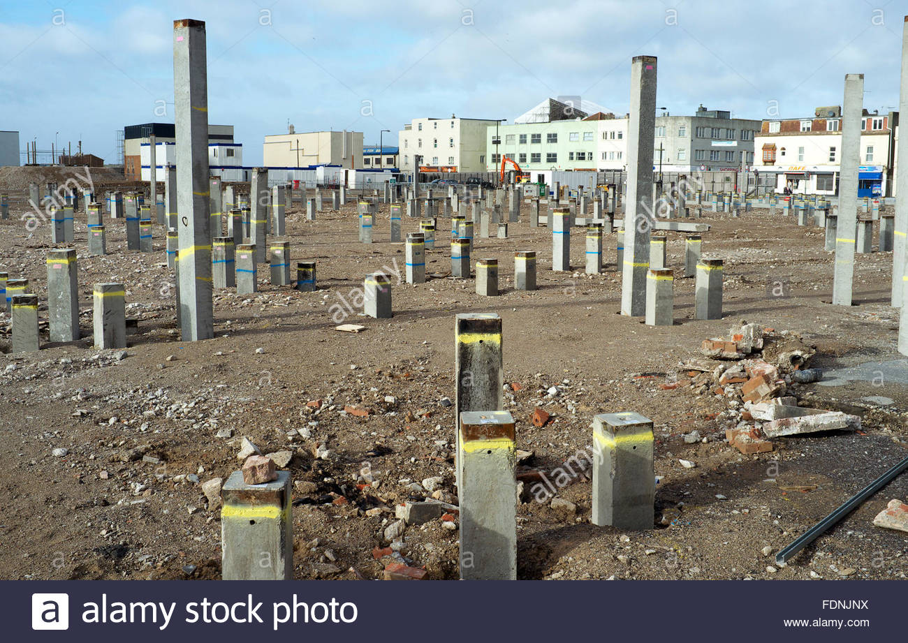 Concrete piles driven in to the ground for a deep for Piling for house foundations