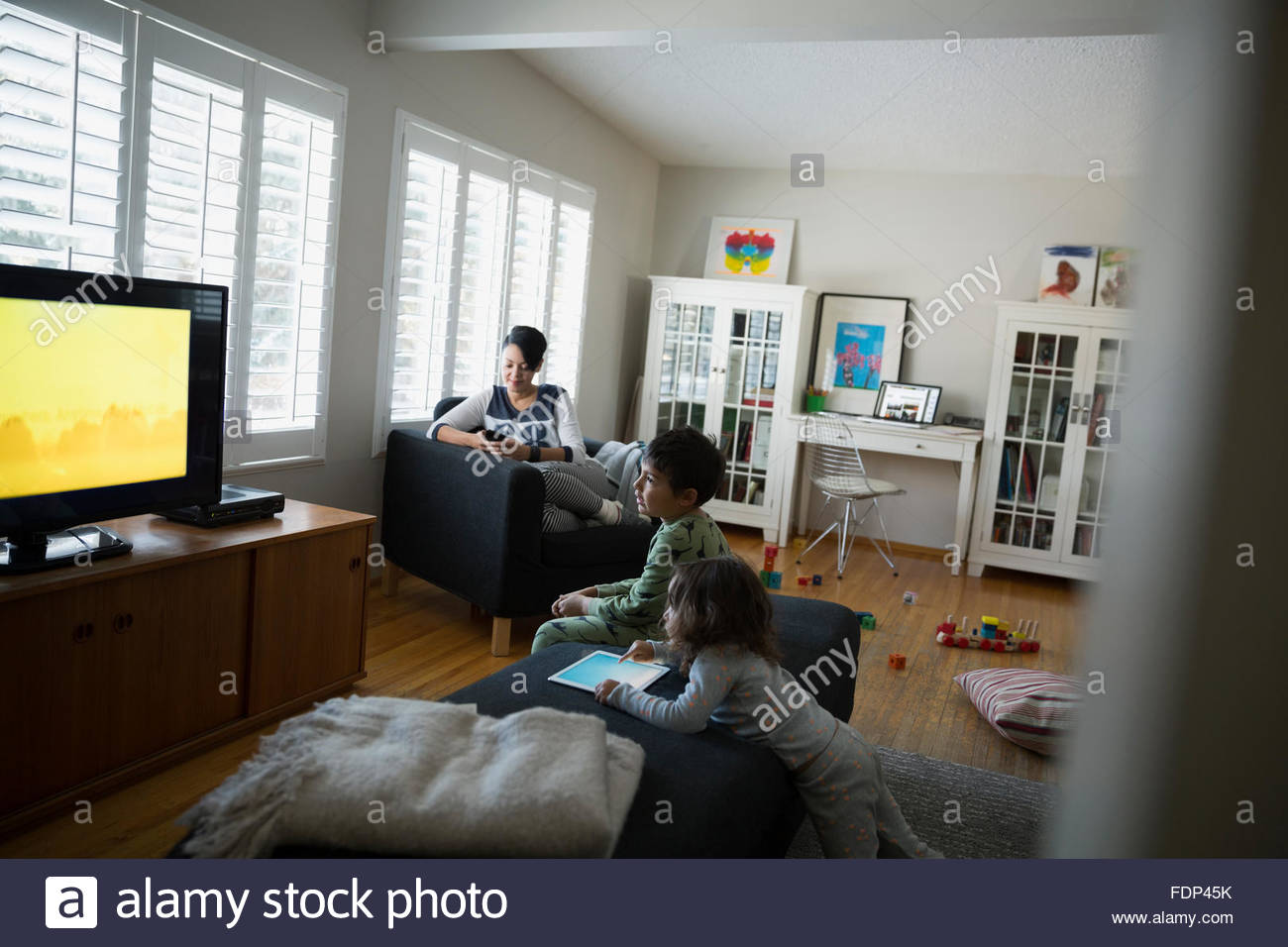 Relaxing Living Room Family Relaxing Watching Tv In Living Room Stock Photo Royalty
