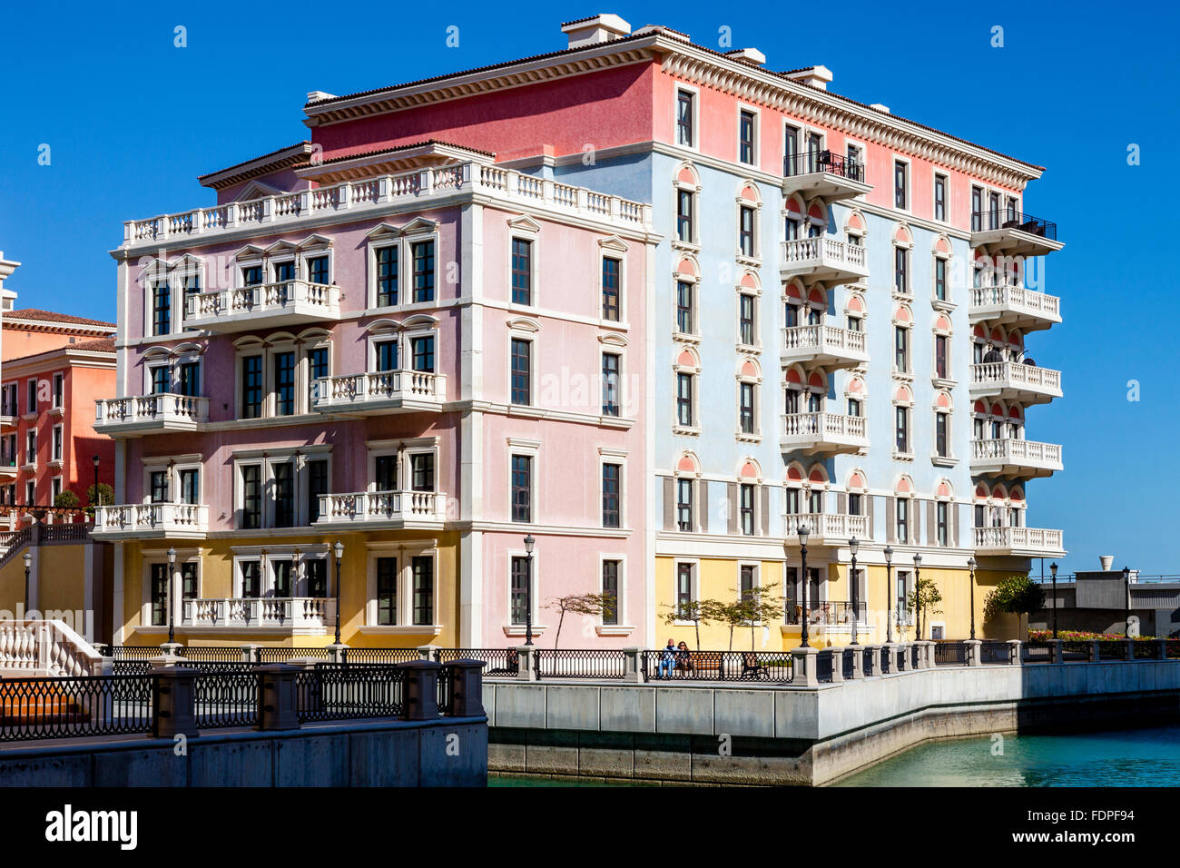 Colourful venetian style houses at qanat quartier the for Venetian style home