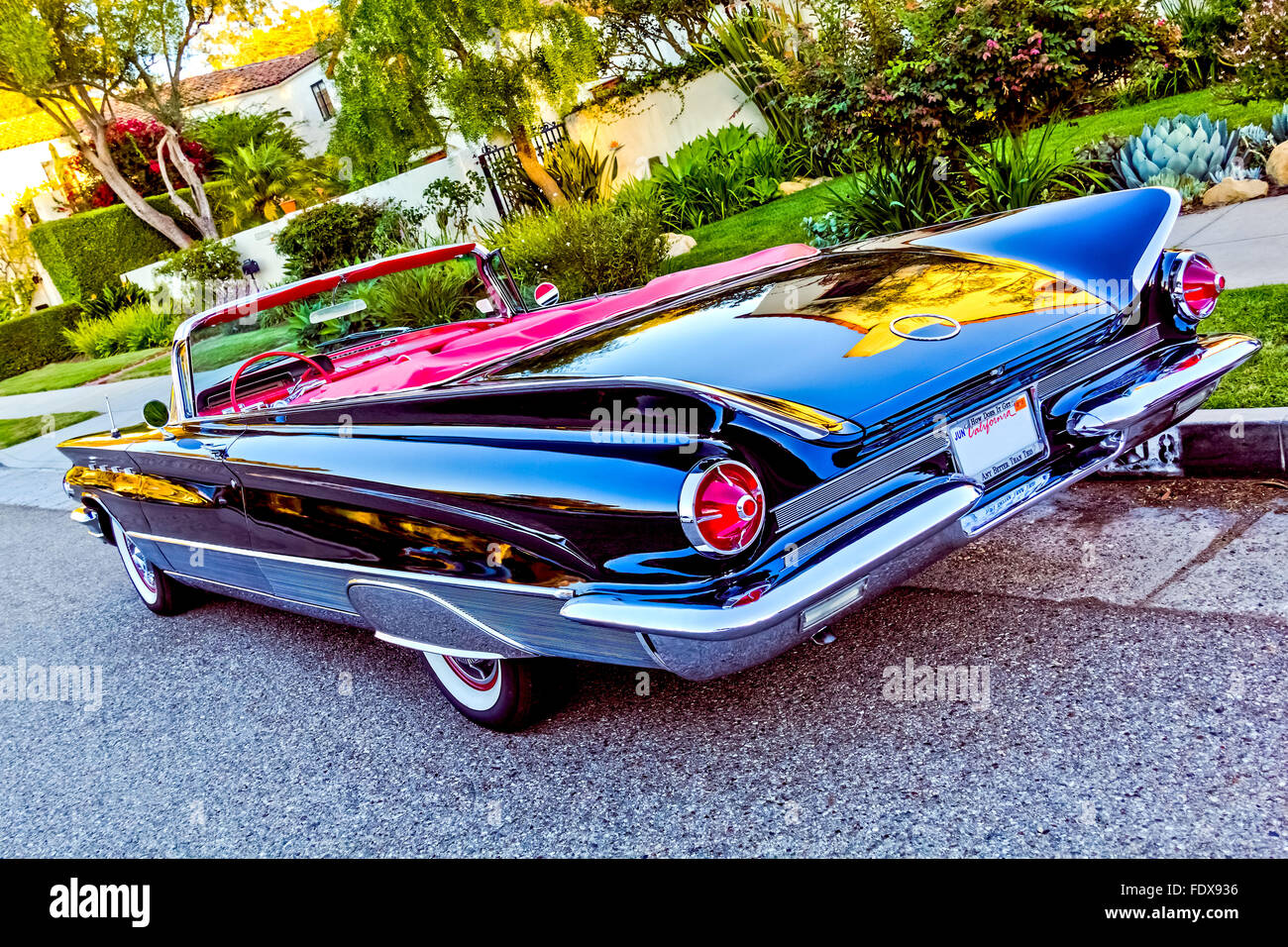 classic american convertible black car with red leather