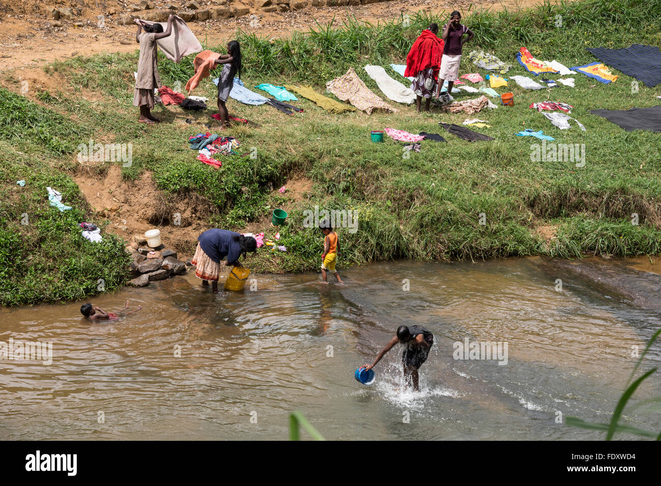 local women bathing and washing in a river near their
