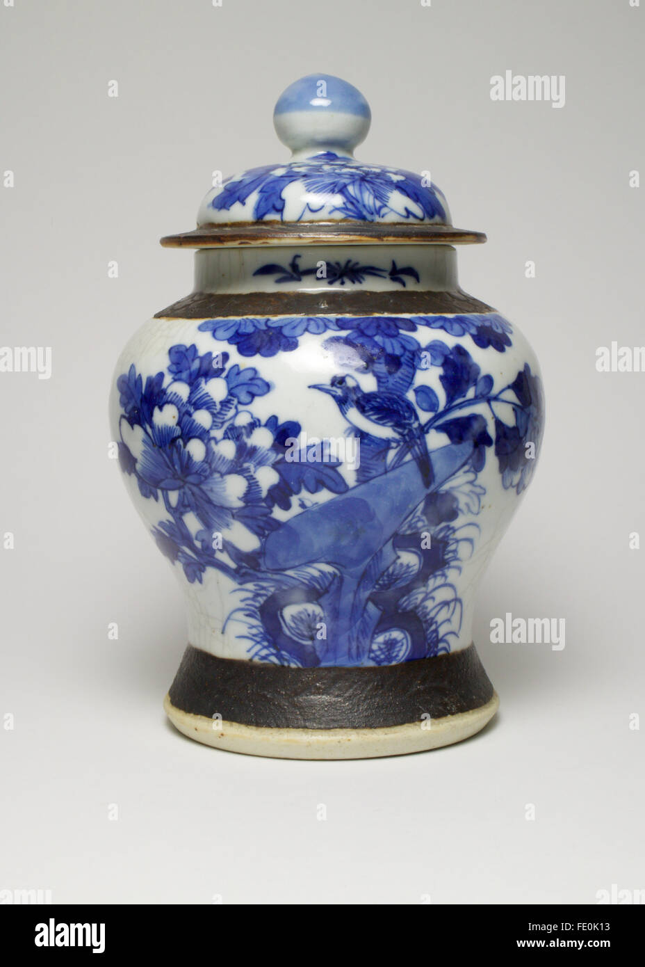 Vintage chinese blue and white porcelain vase and cover painted vintage chinese blue and white porcelain vase and cover painted with a bird sitting on a flowering branch all against a crackle reviewsmspy