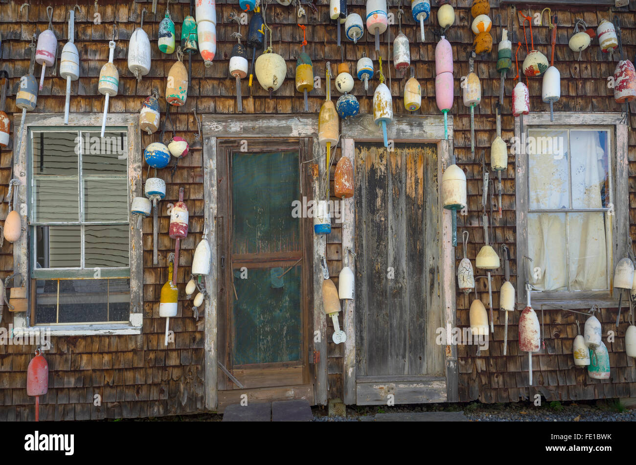 Central Coast; Maine Weathered doors and wall covered with lobster buoys & Central Coast; Maine: Weathered doors and wall covered with ...