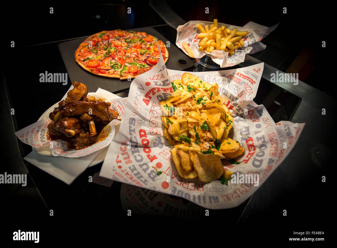 a selection of american diner style food in an english