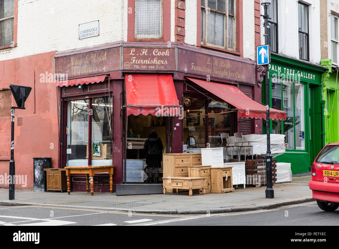 Old fashioned antique shop in London s Portobello Road with furniture  outside the shop on sale on the pavement. Old fashioned antique shop in London s Portobello Road with