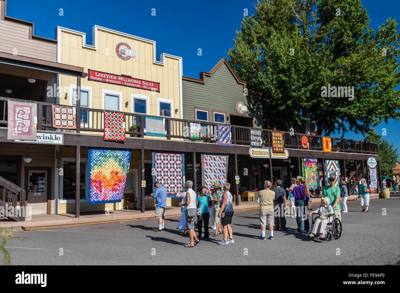 Tourists crossing the street at the Sisters Outdoor Quilt Show ... : quilt show sisters oregon - Adamdwight.com
