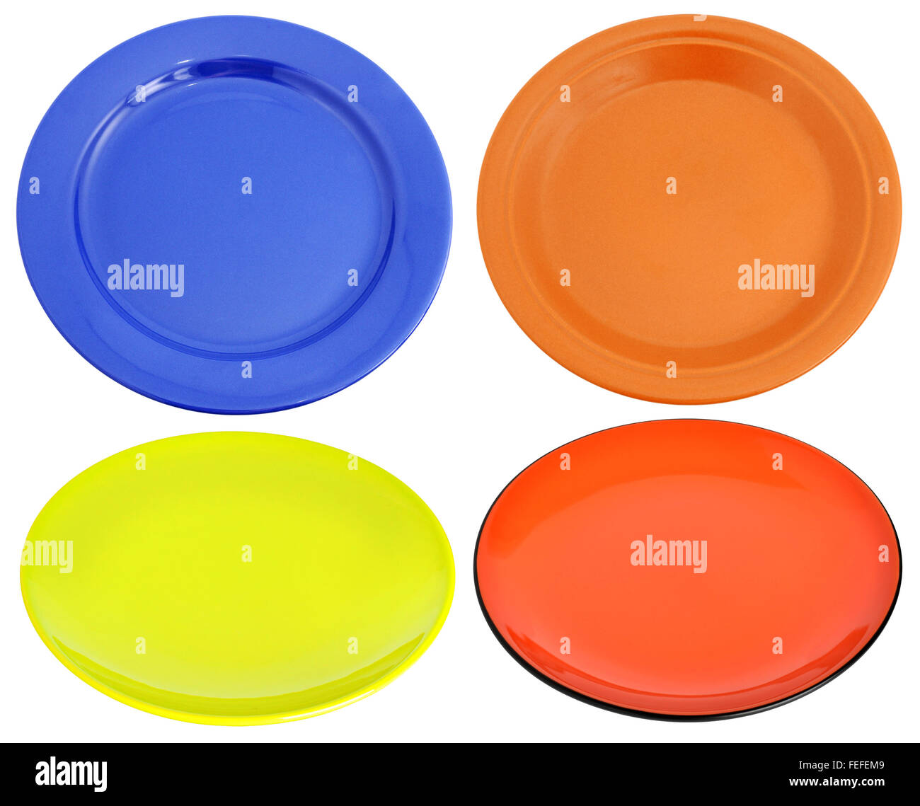 Multi-colored ceramic plates isolated on the white background & Multi-colored ceramic plates isolated on the white background Stock ...