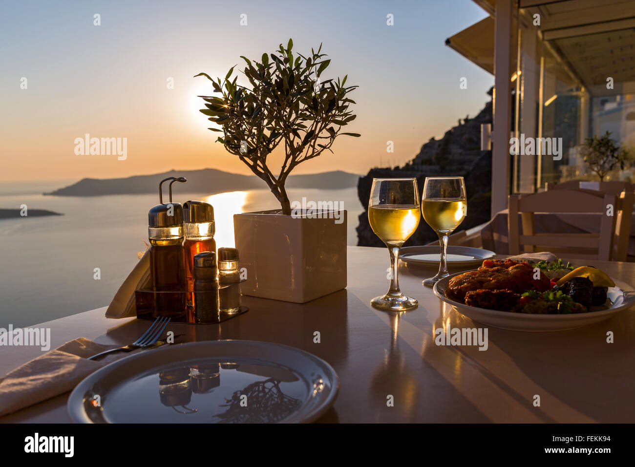 Romantic dinner for two on the island Santorini, Greece. Views of ...