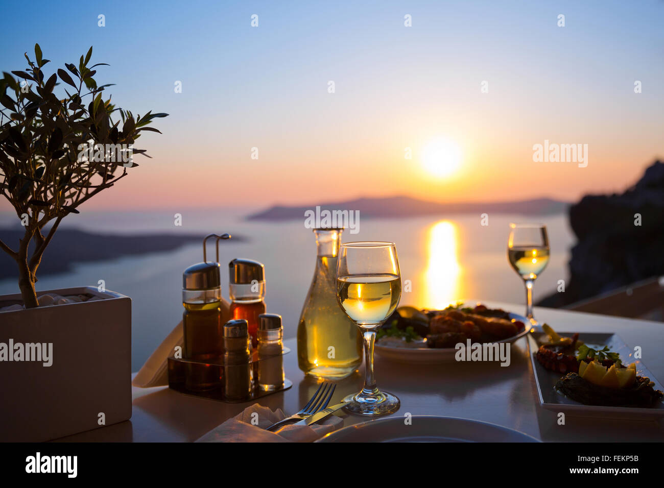 Dinner for two and the sea sunset in Santorini, Greece Stock Photo ...