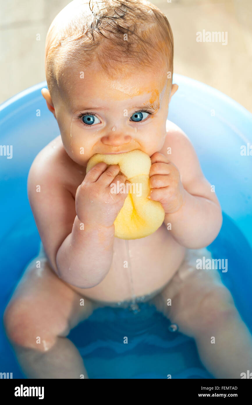 Baby week giveaway 10 angelcare infant bath support andrea dekker - Messy Baby In The Bath Trying To Eat A Sponge Stock Photo