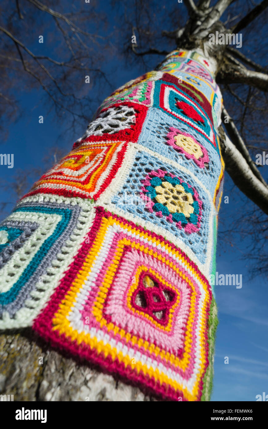 Guerilla knitting closeup of colorful wool patterns around a guerilla knitting closeup of colorful wool patterns around a tree trunk in the olympiapark in munichgermany bankloansurffo Gallery